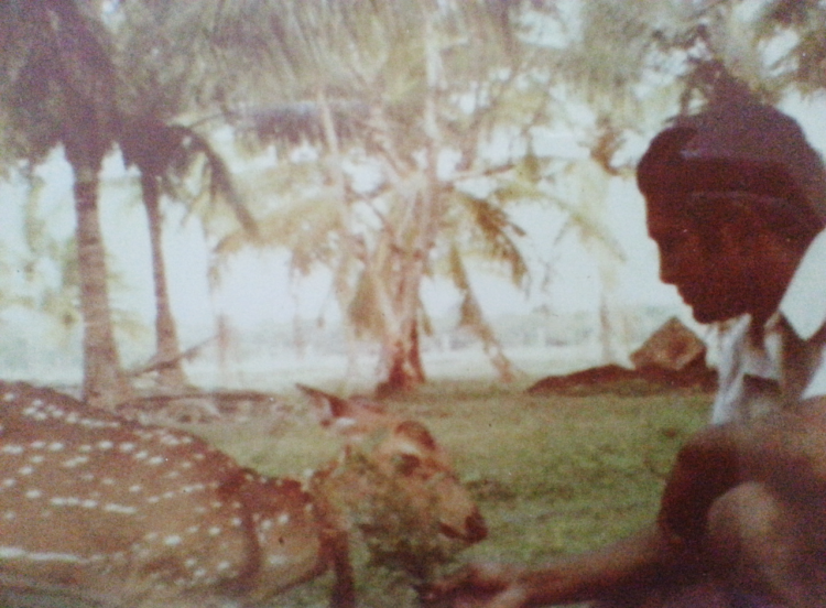 Appa with the pet deer he found abandoned and reared.